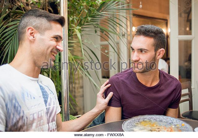 Israel, Tel Aviv, Homosexual couple in cafe - Stock-Bilder