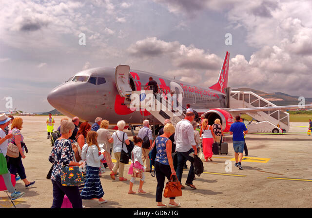 Passengers embarking to a Jet2 aircraft at Split Airport, Croatia, using stairway. - Stock Image