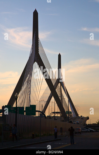 Sunset and the CABLE STAYED ZAKIM BRIDGE that crosses the CHARLES RIVER - BOSTON, MASSACHUSETTS - Stock Image