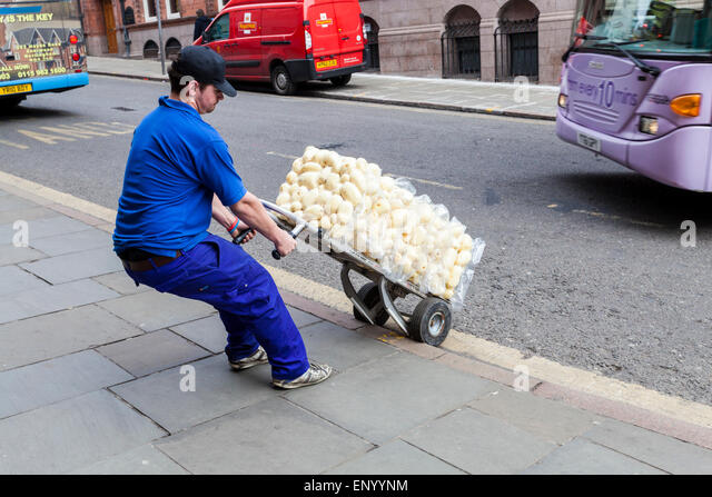 Delivery man delivering potatoes to a restaurant, Nottingham, England, UK - Stock Image