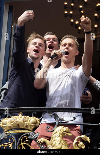 Duesseldorf's Maximilian Beister (L), Thomas Broeker (C) und Ken Ilsoe (R)  stand on the balcony of city hall - Stock Image