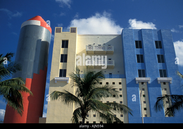 Florida Miami South Beach Art Deco Building Red Blue Palm Trees - Stock Image