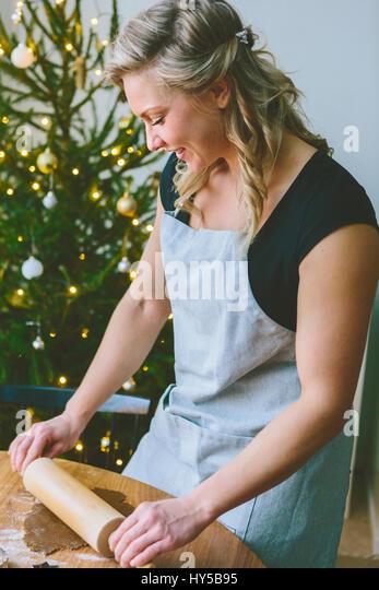 Finland, Woman preparing christmas cookies - Stock Image