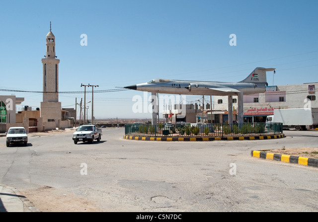 An F-104 starfighter, tops a roundabout in a village in the al-Mafreq region of northern Jordan, near its border - Stock Image