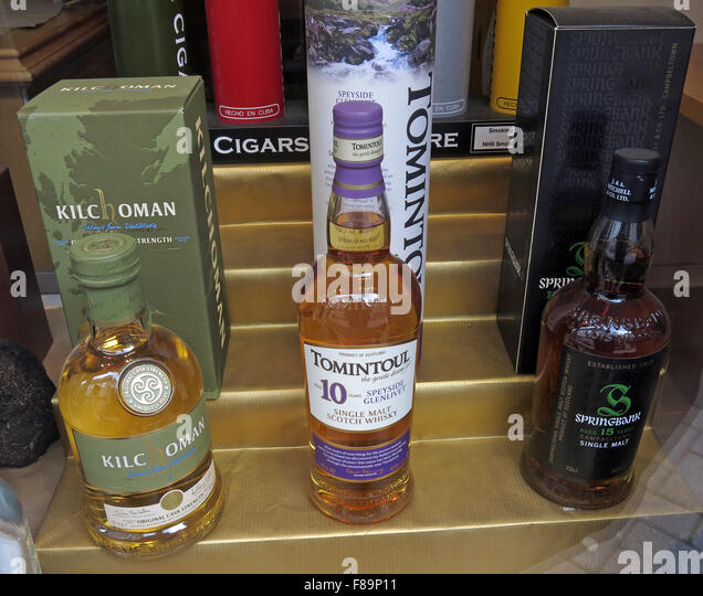 Malt Whiskies in shop window, Edinburgh,Scotland,UK - Stock Image