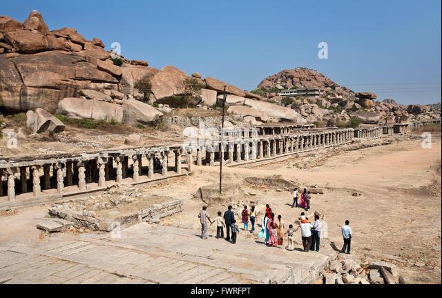 Indian people visiting the ancient ruins of Hampi. Karnataka. India - Stock Image