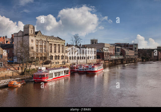 A winter view along the River Ouse, York, North Yorkshire, with pleasure boats of the YorkBoat line and traditional - Stock Image