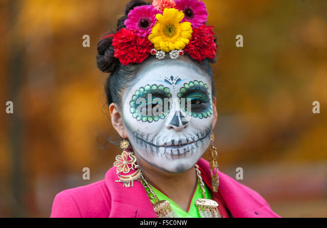 Woman in makeup for Day of the Dead mask, Prague, Czech Republic - Stock Image