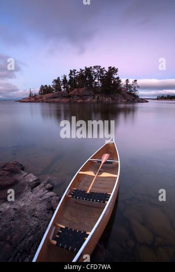 Canoe and Island in Georgian Bay, Killarney Provincial Park, Ontario, Canada. - Stock Image