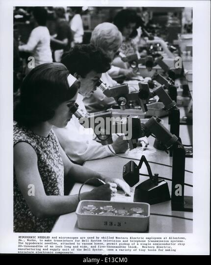 Feb. 29, 2012 - Hypodermic needles and microscopes are used by skilled Western Electric employees at Allentown, - Stock Image