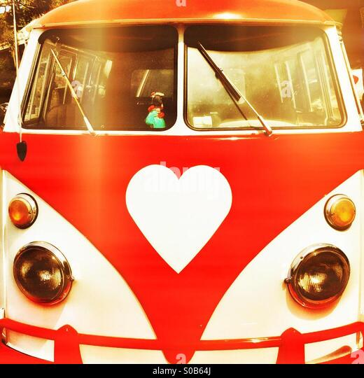 Vintage VW camper with a heart-shaped logo in red - Stock Image