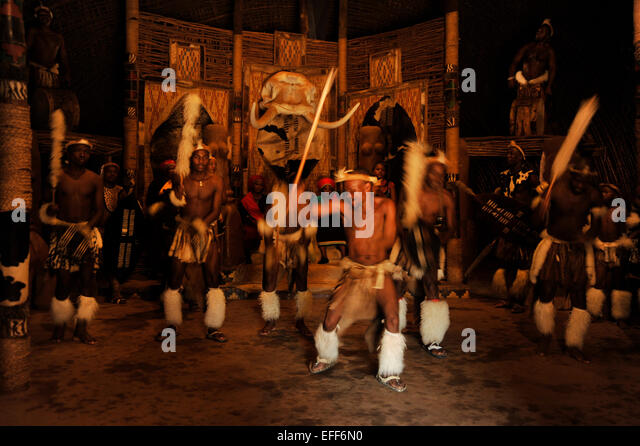 Group of Zulu male dancers performing for tourists at Shakaland culture theme village KwaZulu-Natal South Africa - Stock-Bilder