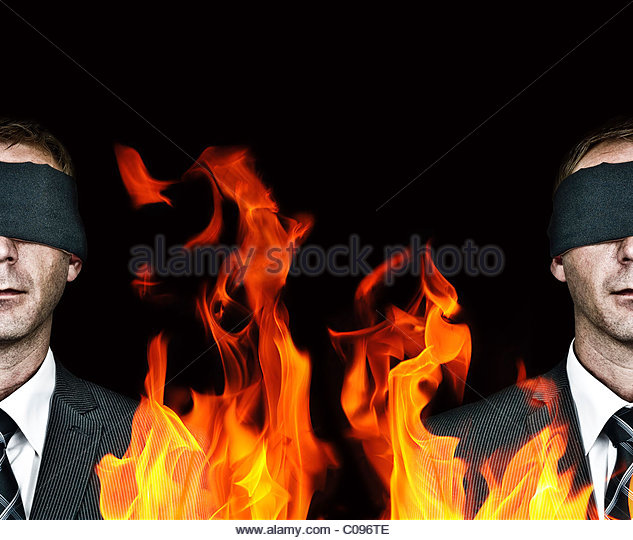 Man blindfolded and fire - Stock Image