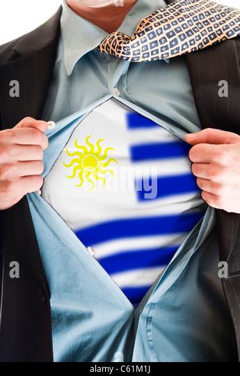 Business man showing Uruguay flag shirt - Stock Image