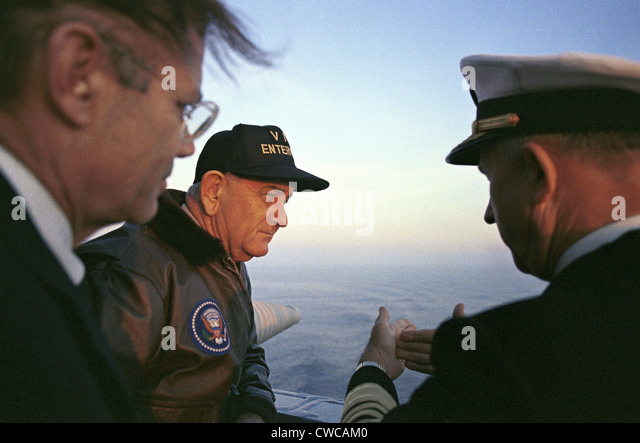 President Lyndon Johnson's tours of the USS Enterprise. Secretary of Defense and LBJ during a Veteran's - Stock Image