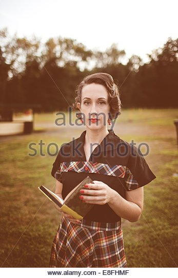 Young woman with book - Stock Image