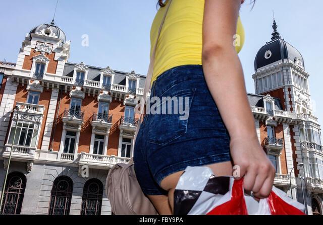 Madrid Spain Europe Spanish Hispanic Centro apartment building woman shopper - Stock Image