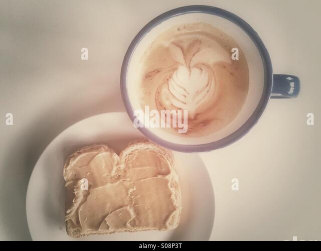 Breakfast - peanut butter and coffee - Stock Image