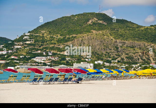 St Maarten Great Bay beach with red umbrellas, a popular swimming beach that parallels Front Street in Philipsburg - Stock Image