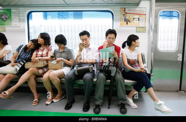 Passengers on Seoul Subway, Seoul, South Korea - Stock Image