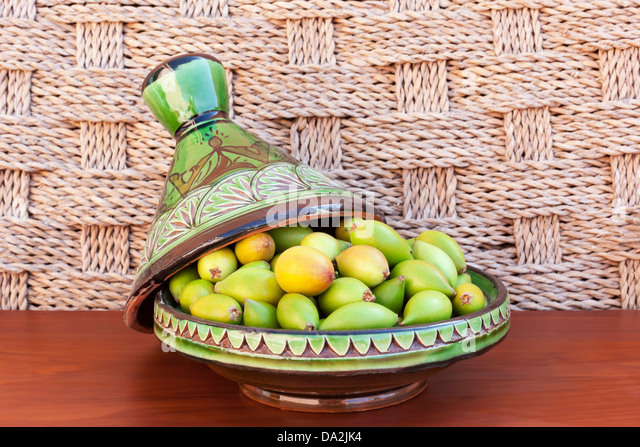 Argan nuts in a green plate. - Stock Image