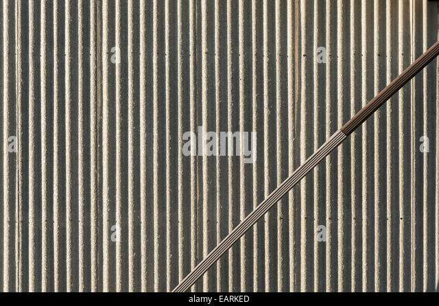 Corrugated Metal Wall With Angled Downspout - Stock Image