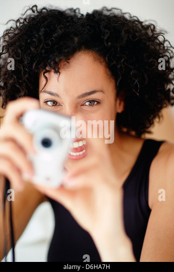 Woman taking a photograph - Stock Image