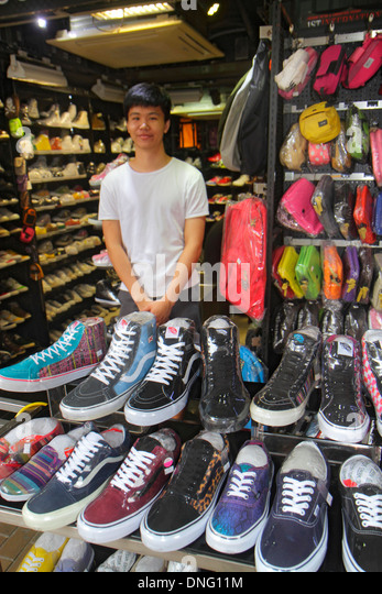 Hong Kong China Kowloon Mong Kok Fa Yuen Street Sneaker Street shopping fashion athletic shoe store inside sale - Stock Image