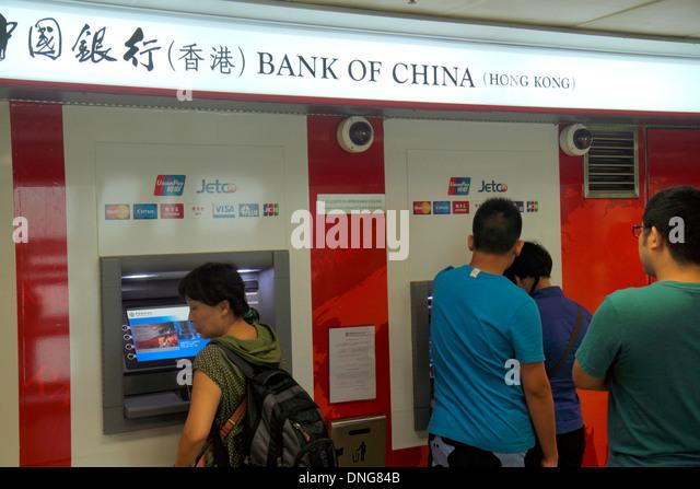 China Hong Kong Island Wan Chai Central Plaza ATM self service banking Bank of China Cantonese Chinese characters - Stock Image