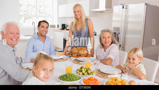 Happy mother serving a turkey - Stock Image