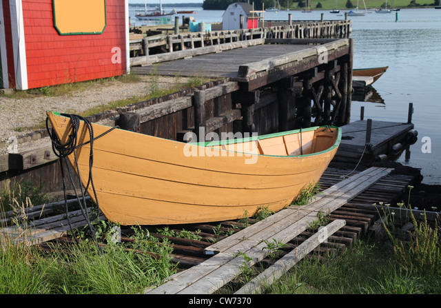A traditional wooden dory on a slipway in Lunenburg, Nova Scotia, Canada. - Stock Image