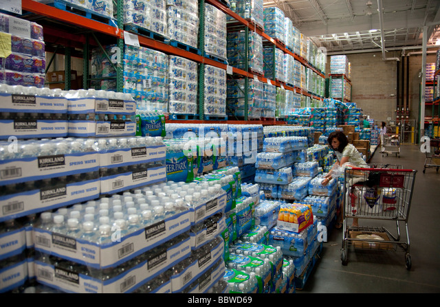 bottled water and kitchen towel stacks, Costco warehouse USA - Stock Image