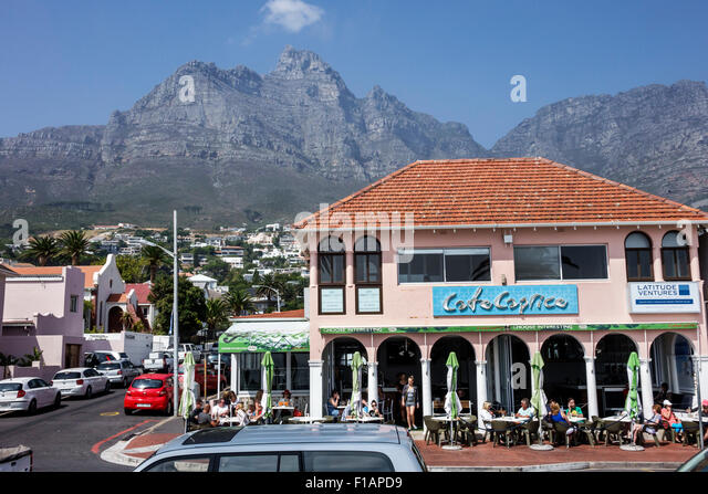 Cape Town South Africa African Camps Bay Victoria Road Table Mountain National Park Cafe Caprice restaurant alfresco - Stock Image