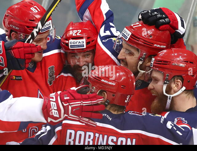 Moscow, Russia. 18th Apr, 2018. MOSCOW, RUSSIA - APRIL 18, 2018: CSKA Moscow's Andrei Svetlakov, Alexander Popov and Kirill Petrov (L-R) celebrate victory in Leg 3 of the 2017/2018 Kontinental Hockey League Gagarin Cup final against Ak Bars Kazan at CSKA Ice Palace. HC CSKA Moscow won the game 3-2 in extra time. Stanislav Krasilnikov/TASS Credit: ITAR-TASS News Agency/Alamy Live News - Stock Image