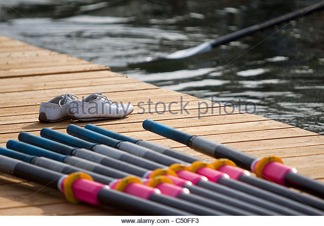 while team Leaving stage for rowing race. A pair of shoe sending them off. - Stock Image