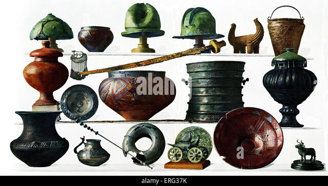 Iron Age grave-goods from Austria and Bosnia including helmets, vessels, sculptures and a sword. - Stock-Bilder