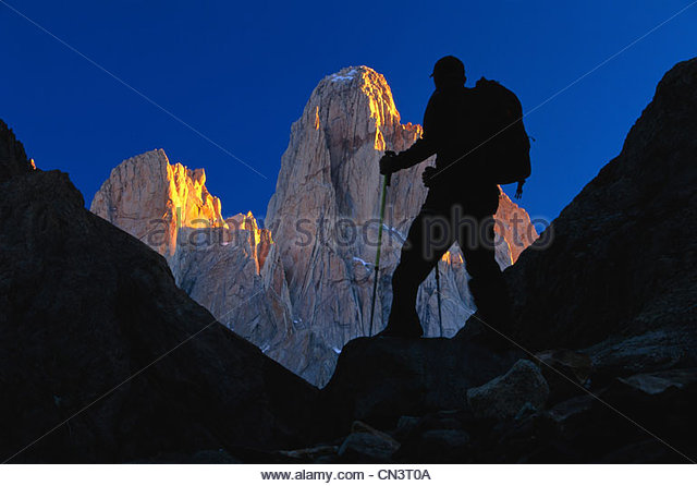 Hiker silhouetted against Monte Fitz Roy, Argentina - Stock Image