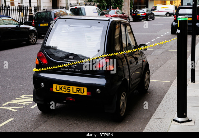 An Electric Car being recharged, Albemarle Street, Mayfair, London, England, UK - Stock Image
