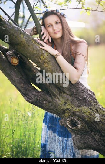 Beautiful woman enjoying nature . Serenity and harmony conceptual - Stock Image