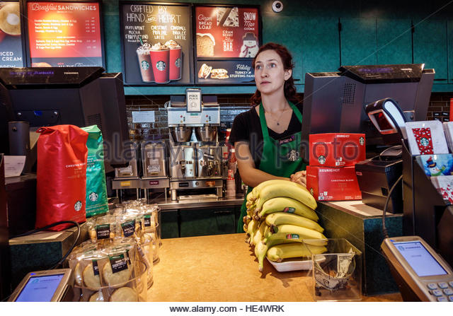 Florida Bonita Springs Starbucks Coffee interior counter woman barista employee - Stock Image