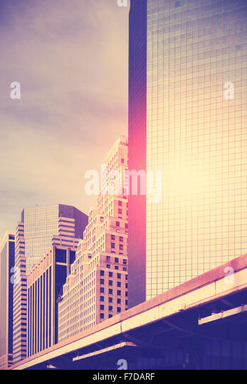 Vintage toned skyscrapers at sunset, space for text, New York, USA. - Stock Image
