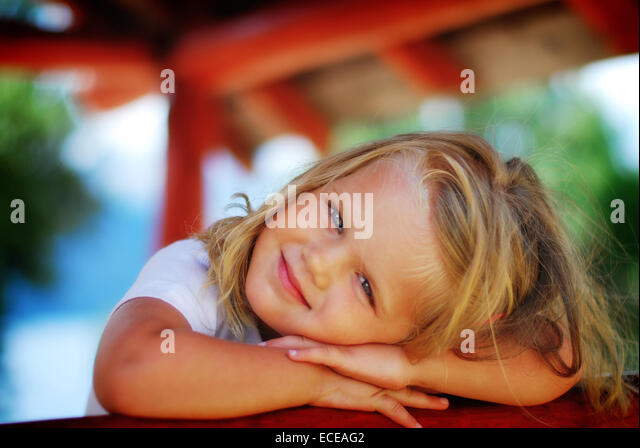 Argentina, Rio Negro, Portrait of little girl smiling - Stock Image