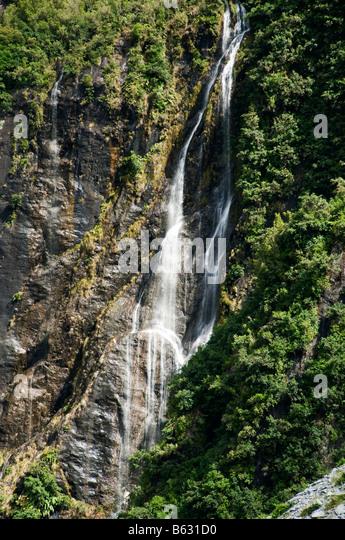 Waterfall near Franz Josef, South Island, New Zealand - Stock Image