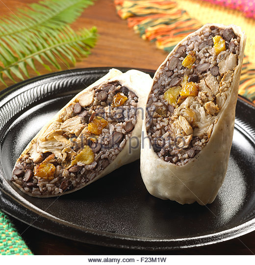 Chicken black bean sweet plantain and rice wrap - Stock Image
