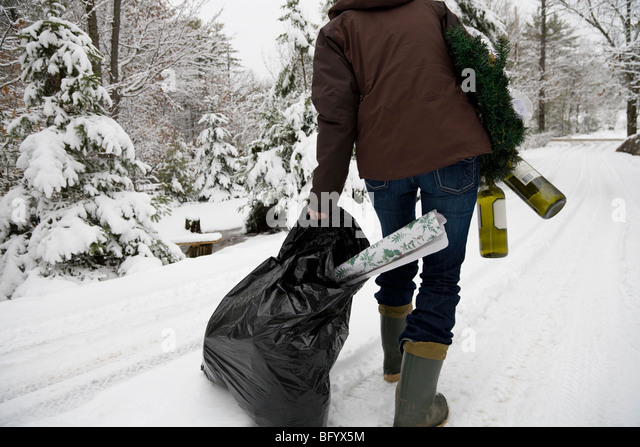 Woman disposing of festive leftovers - Stock Image