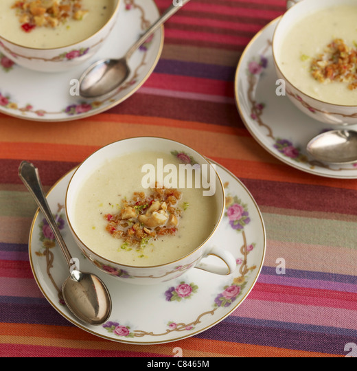 Parsnip soup in teacups - Stock Image