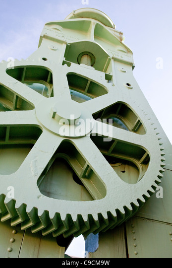 Cog wheel on gigantic plate bending roller - Stock Image