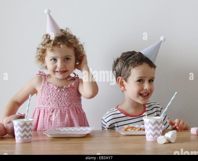 China, Hong Kong Island, Hong Kong, Kids (2-3), (4-5) at party - Stock Image