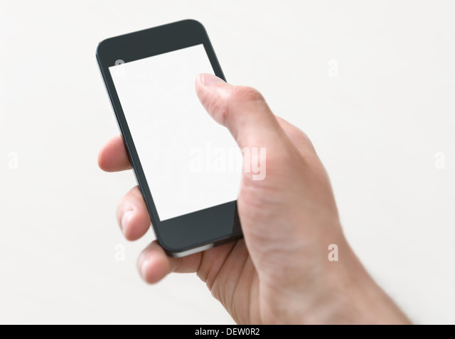 Male hand holding and touching on mobile smartphone with blank screen. Isolated on white background. - Stock Image