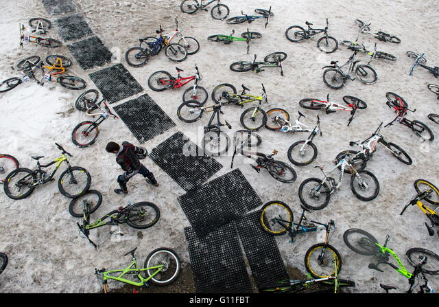 Sochi, Russia. 7th May, 2016. Bikes lying on the ground ahead of in a mass downhill mountain biking event on alpine - Stock Image